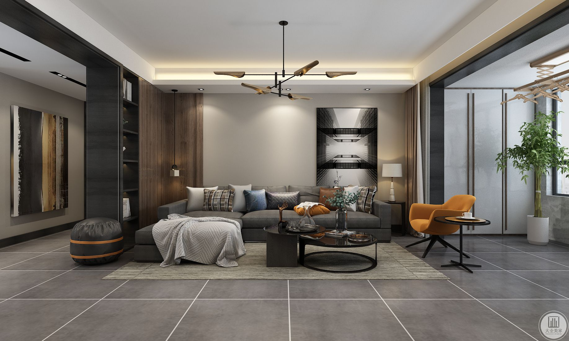 客厅地面使用灰色瓷砖,茶几沙发都采用深色,地毯使用浅灰色,沙发背景墙的挂画放置一侧。