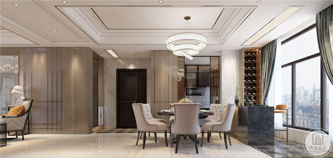 一层餐厅靠近入户门,餐桌使用黑色搭配白色装饰,餐桌一侧是大理石吧台。