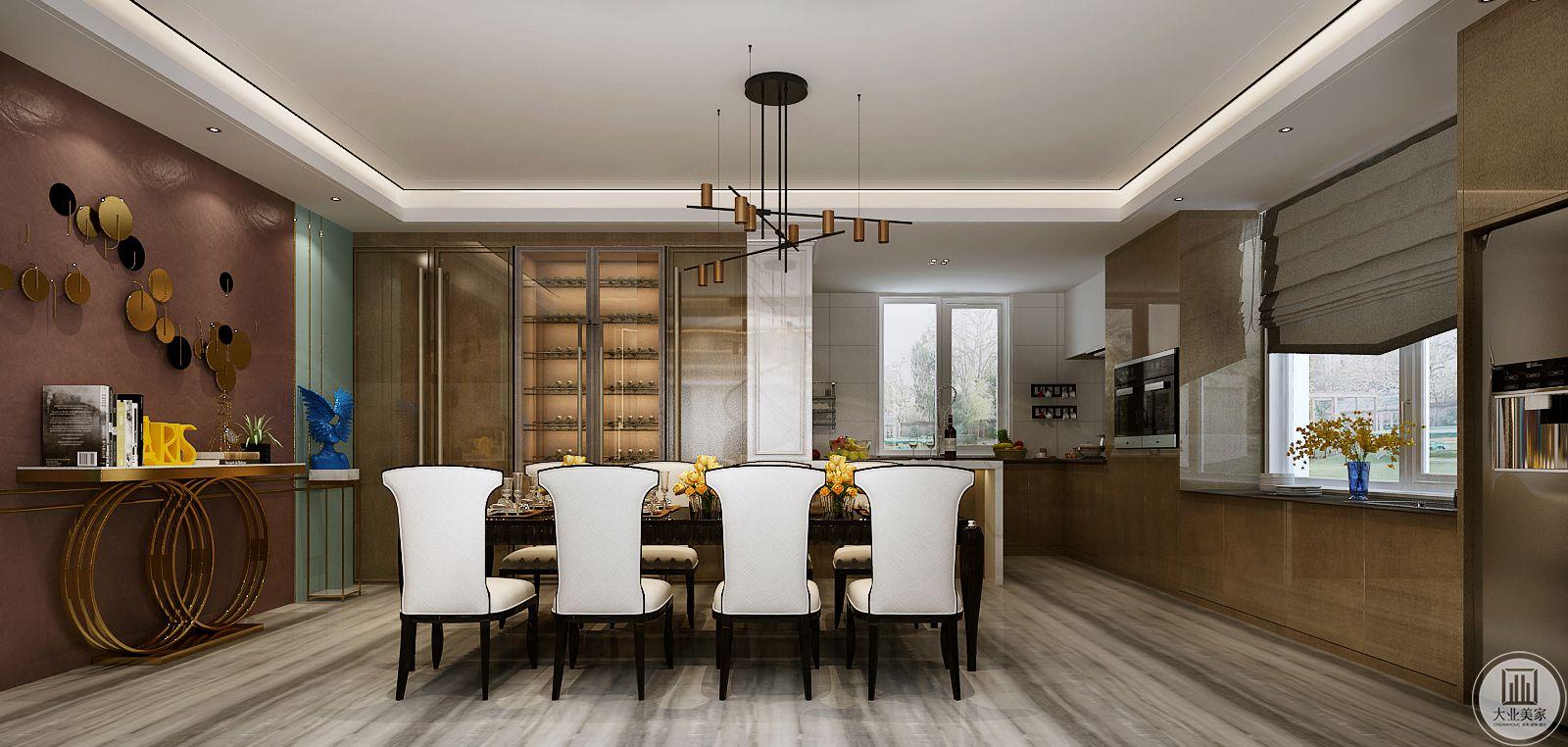 厨房采用半开放式厨房,采用大理石台面的吧台隔开餐厅和厨房。