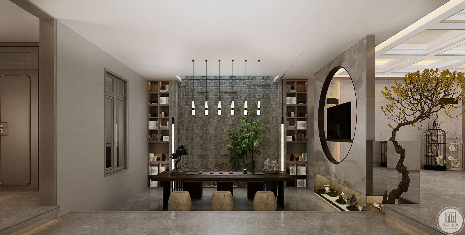 书房采用下沉式设计,地面采用灰色瓷砖,用方圆搭配的方式隔开两个空间。