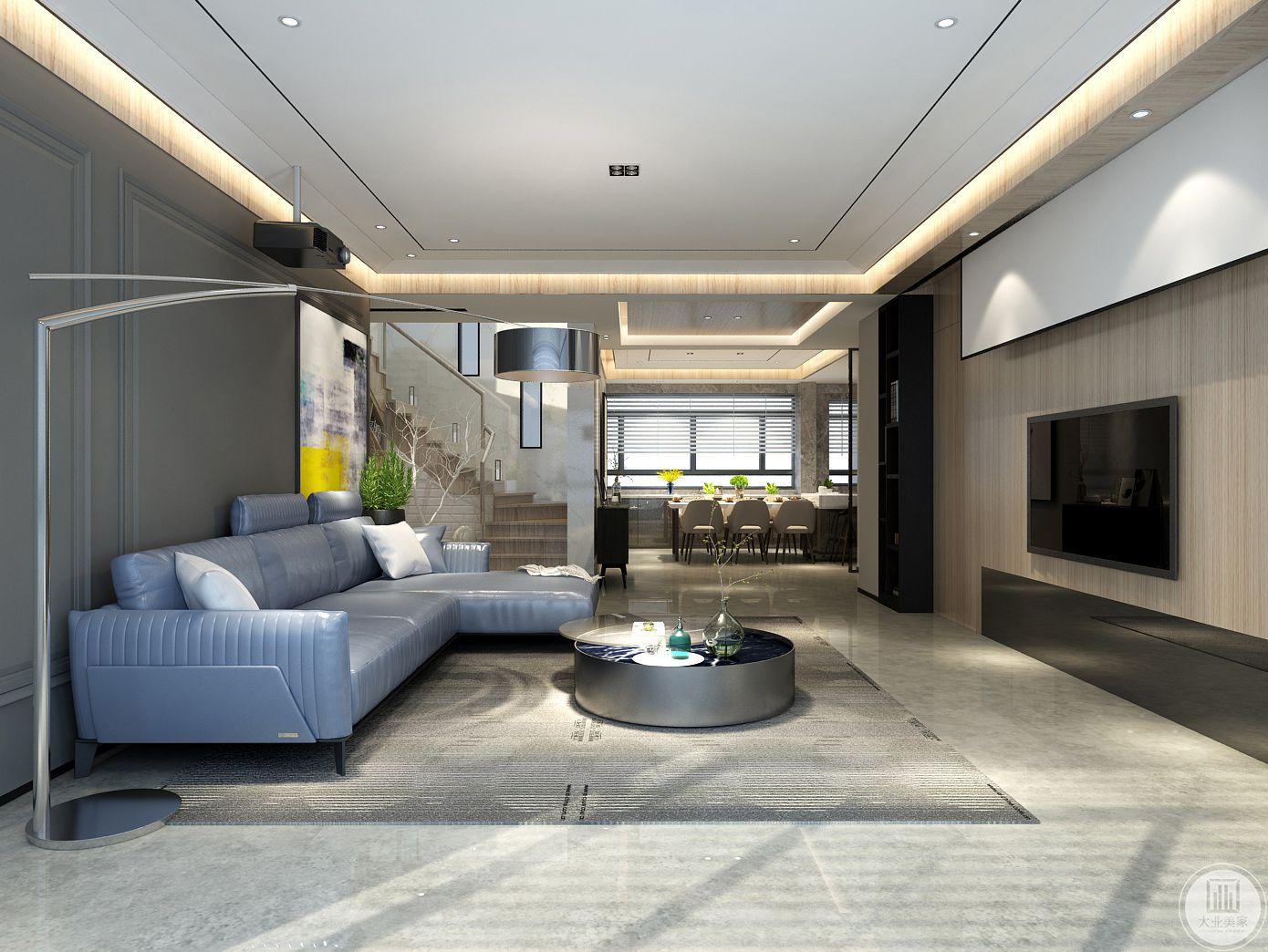 从这个方向可以看到客厅和餐厅的整体布局,地面铺设浅灰色瓷砖,搭配深灰色地毯。
