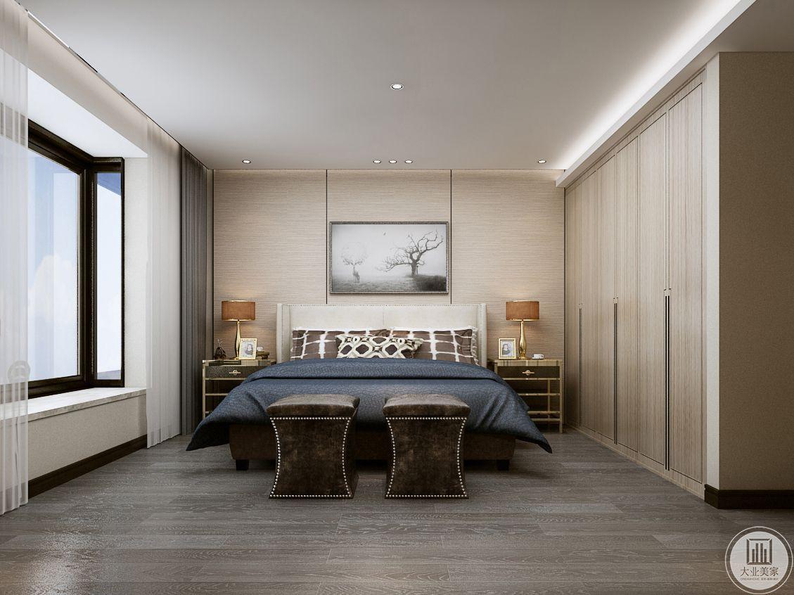 卧室采用浅色实木护墙板,墙面采用黑白色现代装饰画,地面铺浅色木地板,一侧衣柜采用实木衣柜。