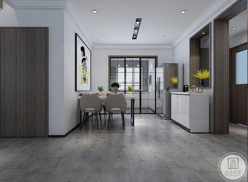 餐桌采用现代装饰设计,一侧搭配白色橱柜,厨房门采用黑框玻璃门。