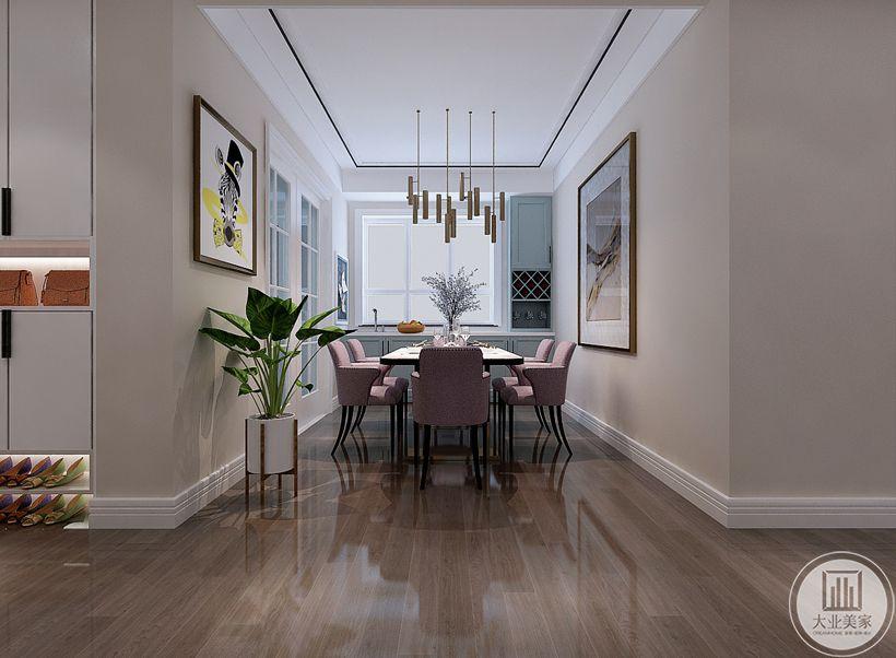 餐厅采用白色木质餐桌,搭配粉色餐椅,