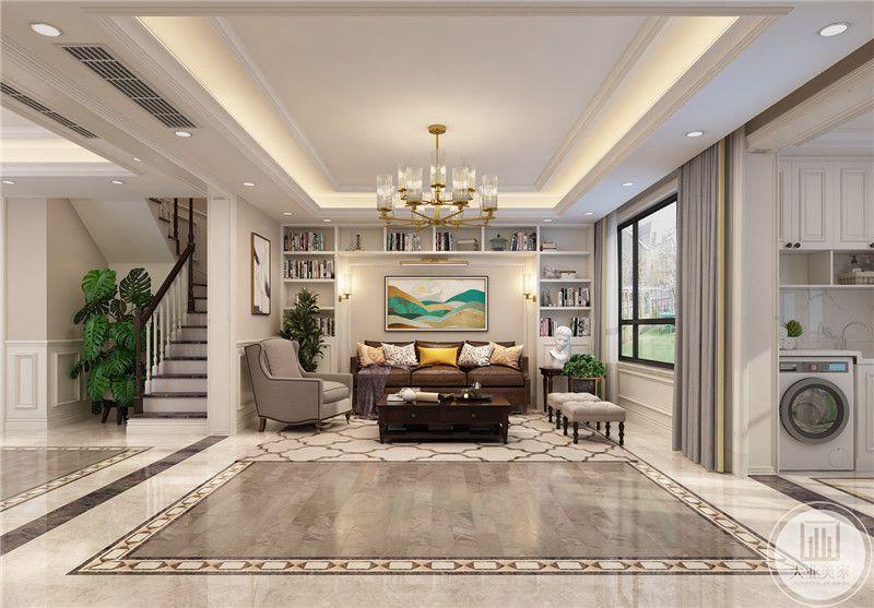一楼客厅的沙发墙采用嵌入设计,装饰画采用现代风的装饰画,周围墙面做成收纳柜,沙发采用棕色沙发搭配米色沙发,茶几采用红木材料。
