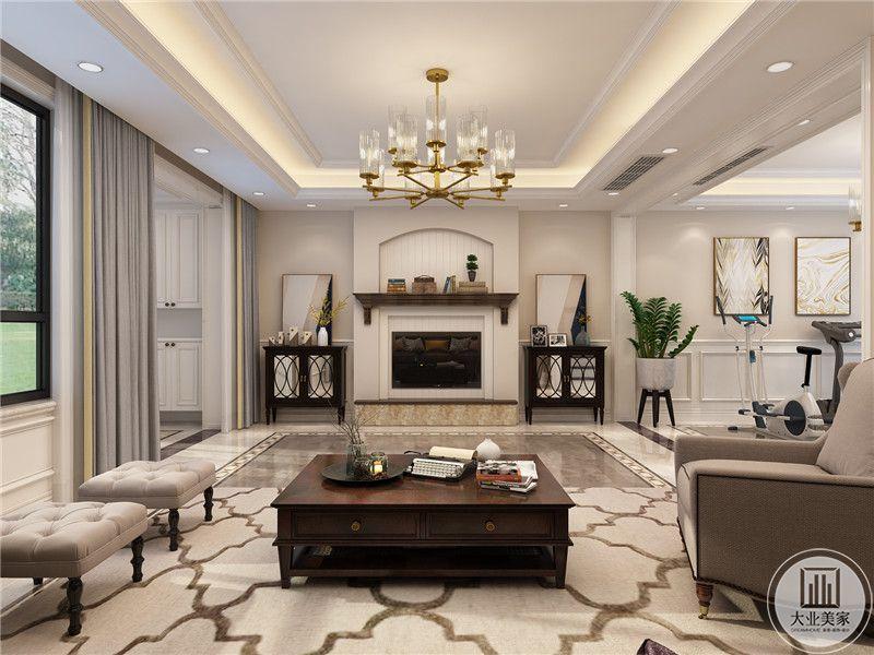 客厅影视墙做成壁炉的风格,电视嵌入到墙面,两侧采用黑色实木柜,上面摆放现代抽象画。