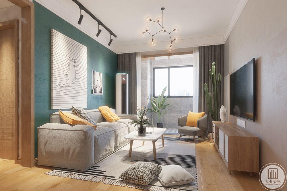 深色地毯的搭配让整个客厅脱颖而出,简约大方的木质地板,矮背布艺沙发和几款尖腿家具简约而时尚。
