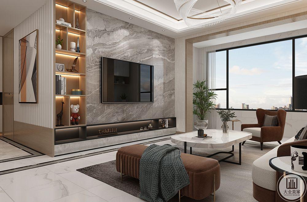 电视背景墙采用灰白纹理天然大理石铺贴,电视下方留空,加入等待增添层次,呈现赋有低奢品质的里面设计。