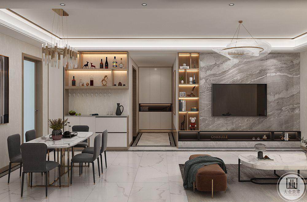 玄关处的地面分区,对整个空间进行虚拟分区,设计镂空的衣帽柜,放不安进门就近使用。
