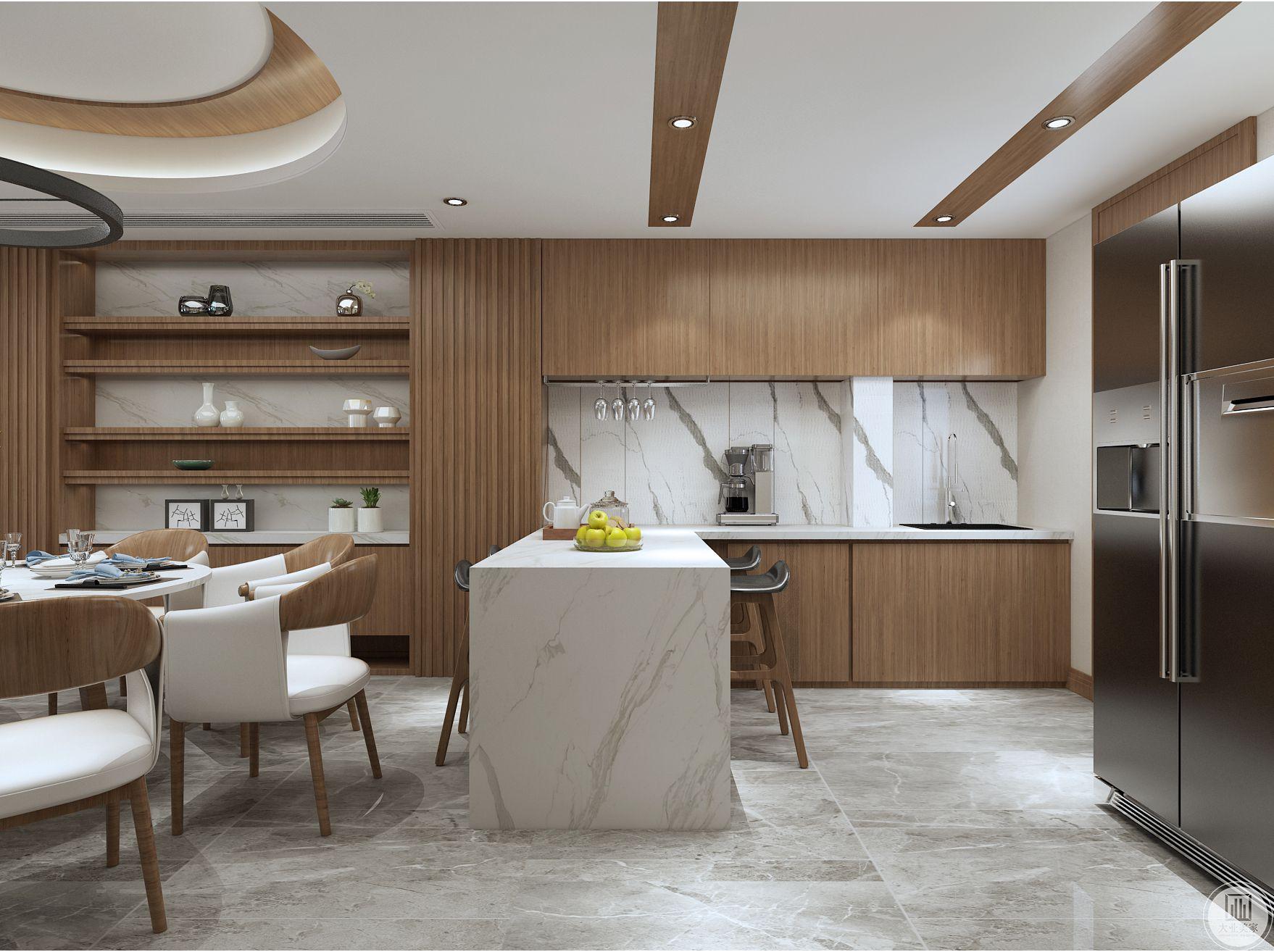 西餐区做了白色大理石面吧台,为餐厅营造了温馨的氛围。靠墙定制了储物柜,让整个看起来整齐、干净、利落。