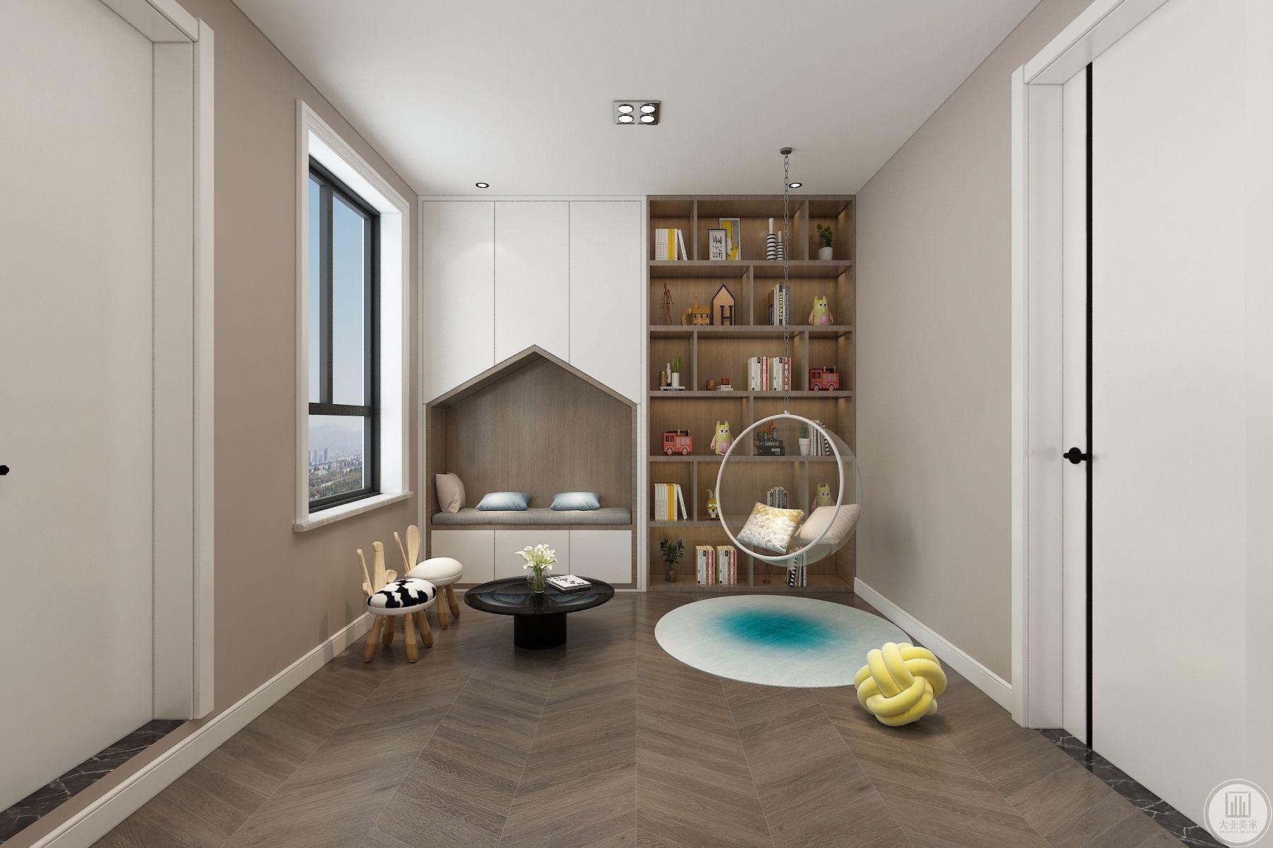 儿童空间地面用木地板做人字拼,简单洋气,前面书柜加储物柜,增加储物空间